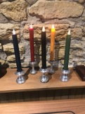 Eric will make you a set of candle holders from old Campagnolo hubs and rainbow jersey colored candles.